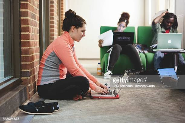 Students on their laptops study in the Brody Learning Commons, a study space and library on the Homewood campus of Johns Hopkins University in...