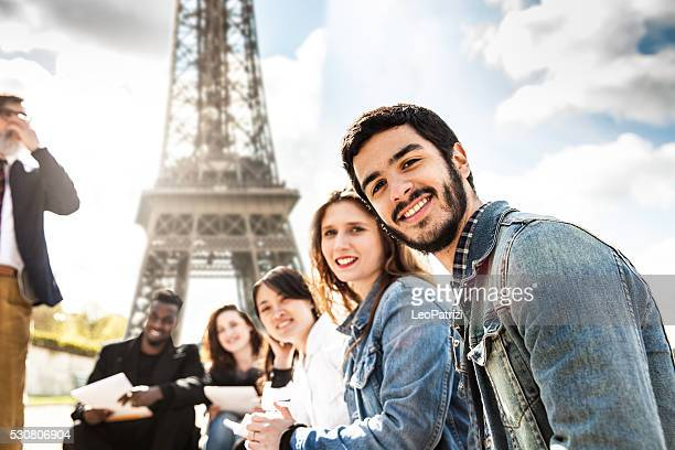 Students on travel in Paris - Tour Eiffel Outdoor lesson