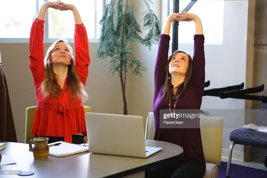 Students or Young Business Women Doing Yoga Stretching Working Studying : ストックフォト