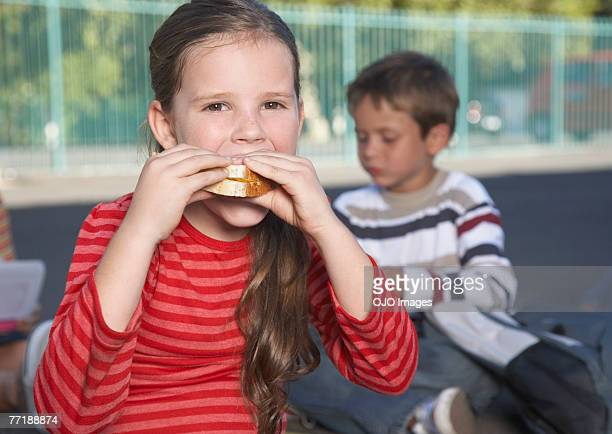 Students outside of school eating