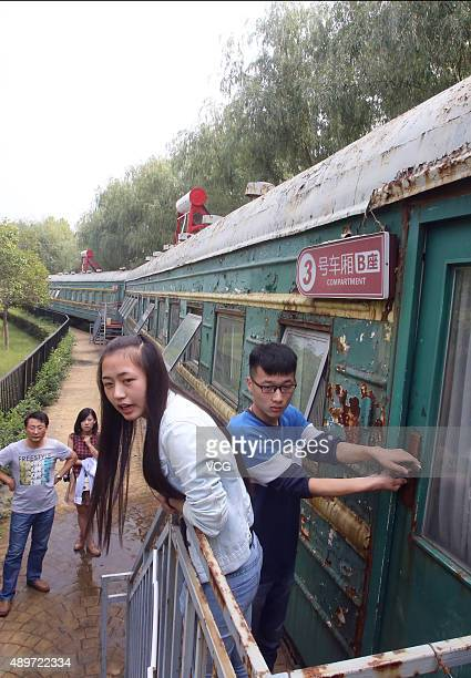 Students outside of their dormitory which was converted from a retired train at Sihe Art School on September 23 2015 in September 23 2015 in...