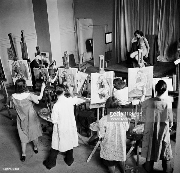 Students painting a nude model in a life class at Slade School of Fine Art London December 1940