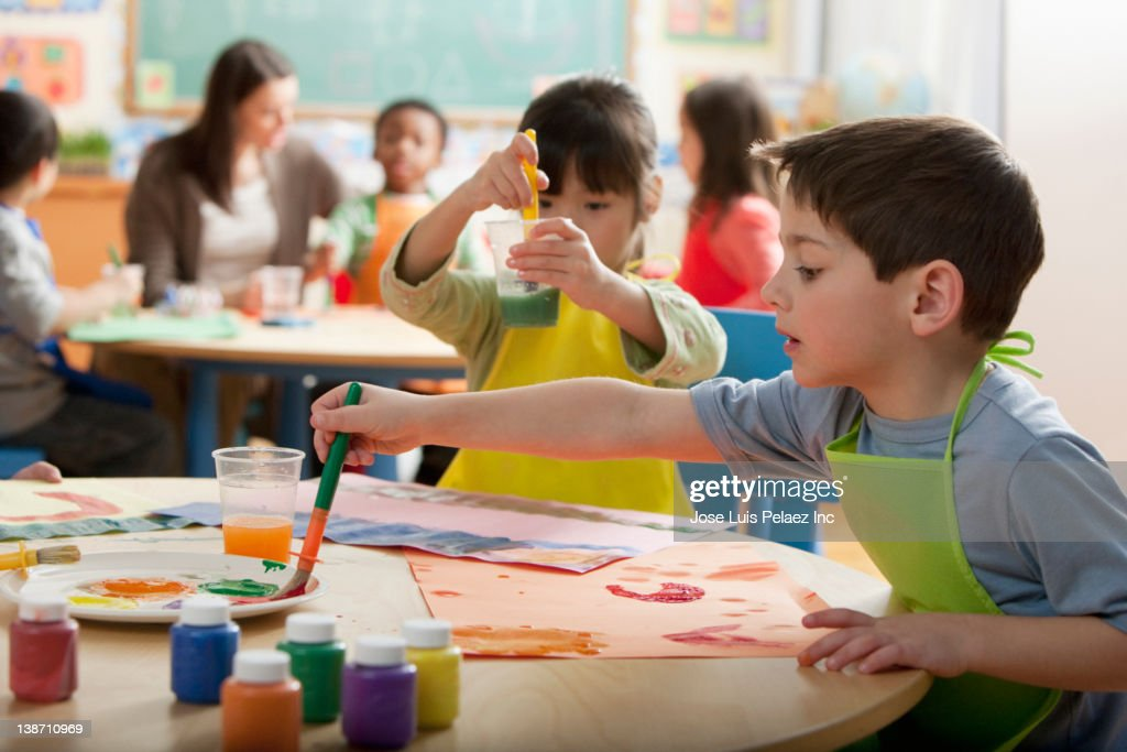 Students painting in art class : Stock Photo