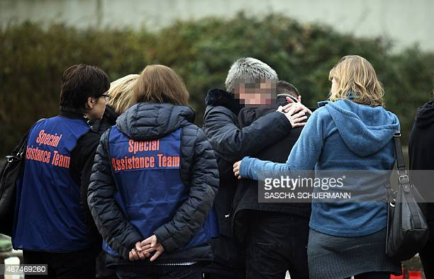 Students parents and helpers gather at a memorial of flowers and candles in front of the JosephKoenigGymnasium secondary school in Haltern am See...