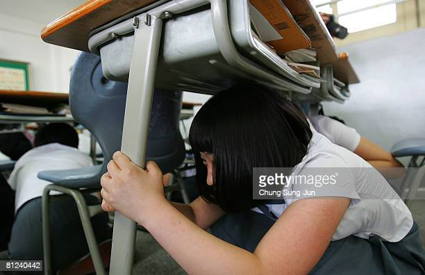 Students participate in a 40minute earthquake drill at Seolin Middle School on May 27 2008 in Seoul South Korea In the wake of the recent earthquake...