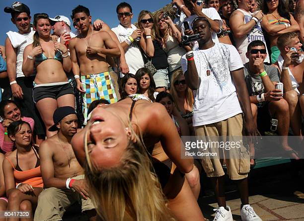Students participate in a booty shaking contest at the MTV Beach Bash party put on by Global Groove at the Bahia Mar Hotel during the annual ritual...