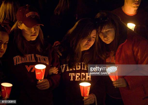 Students participate in a candle light vigil on Drill Field at Virginia Tech 17 April 2007 in Blacksburg, Virginia, one day after the university was...