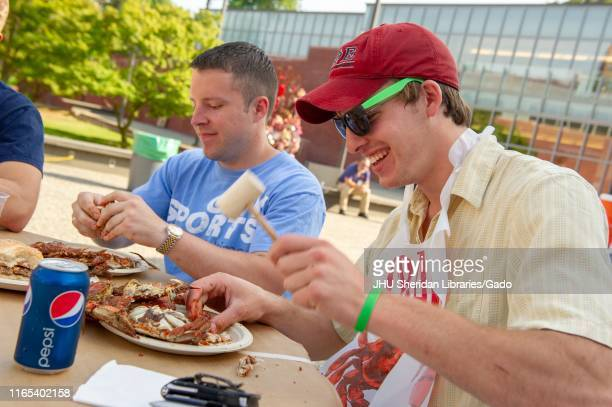 Students participate in a crab feast with the traditional Maryland dish of blue crabs on the Homewood Campus of the Johns Hopkins University in...