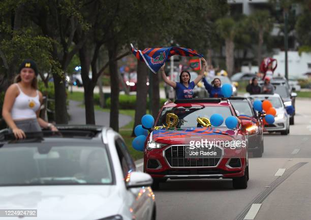Students participate in a parade of vehicles celebrating the area's graduating 2020 High School seniors on May 14 2020 in Aventura Florida The...