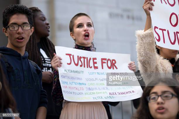 Students participate in a protest against gun violence Los Angeles California on March 14 2018 Students across the US walked out of classes to...