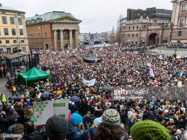 Students participate in a strike outside of the Swedish parliament house Riksdagen in order to raise awareness for global climate change on March 15...