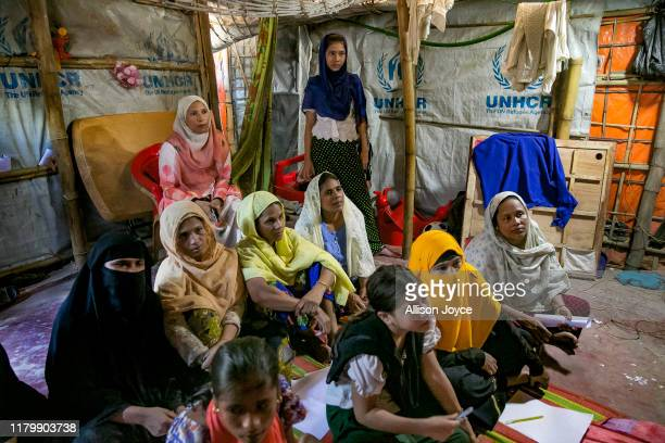 Students participate in class in a shelter in the camp on October 28, 2019 in Cox's Bazar, Bangladesh. 27 year old Rohingya refugee Shamima Bibi is...
