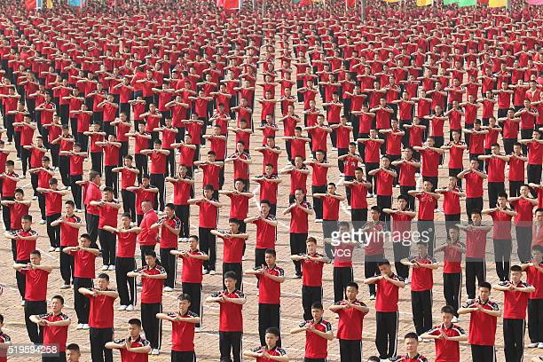 Students participate in the annual spring training at Tagou Martial Arts School near the Shaolin Temple on April 7 2016 in Dengfeng China There are...
