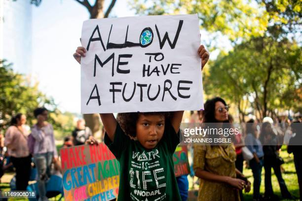 Students participate in the Global Climate Strike march on September 20, 2019 in New York City. - Crowds of children skipped school to join a global...