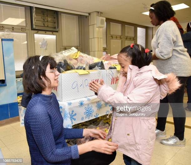 Students participate in the HM And Children's Health Fund Celebrate Giving Tuesday at PS 36 The Margaret Douglas School on November 27 2018 in New...