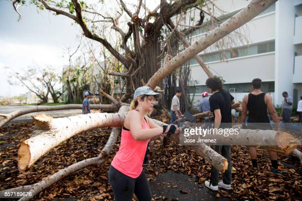 Students participate in voluntary cleaup works at the University of Puerto Rico on October 3 2017 The campus sustained damages after Hurricane Maria