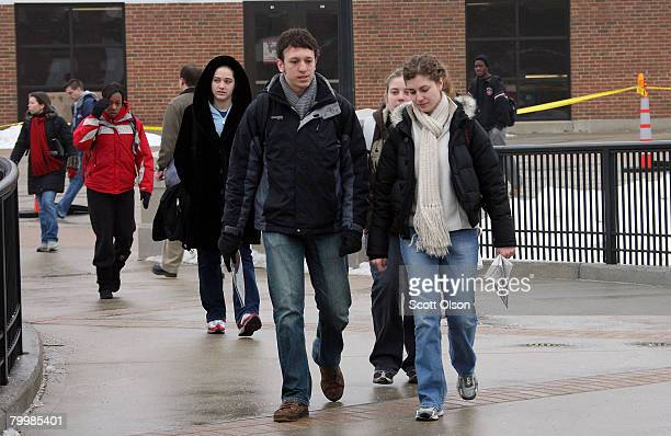 Students pass by Cole Hall as they walk to class at Northern Illinois University February 25 2008 in DeKalb Illinois Classes resumed at NIU today for...