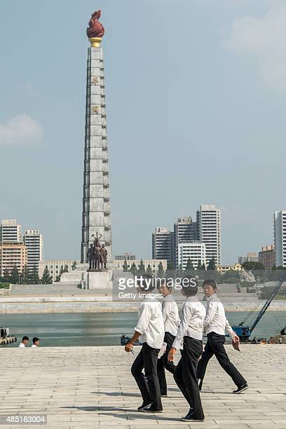 Students pass by the Juche Tower on August 23 2015 in Pyongyang North Korea North and South Korea today came to an agreement to ease tensions...