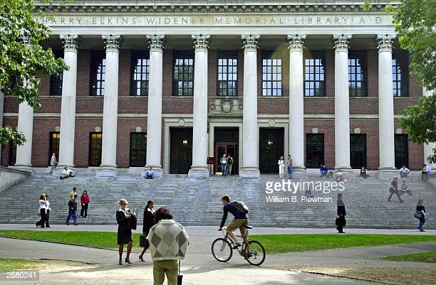 Students pass in front of Harvard's Widener Library on October 10 2003 in Cambridge Massachusetts