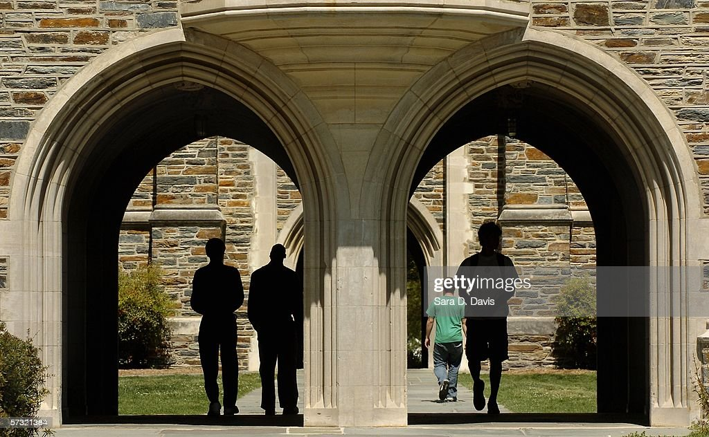 Students pass under the arches at Duke University Tuesday, April 11, 2006 in Durham, North Carolina. The investigation into the Duke lacrosse players regarding allegations of a sexual assault of a woman hired as a private dancer March 13 are continuing despite DNA tests having have found no evidence linking the lacrosse players with the alleged rape.