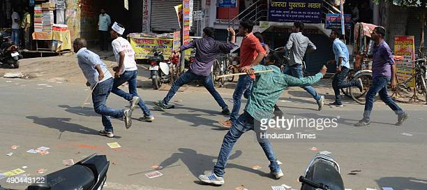 Students pelting stones and hurling crude bombs during qualifying speech of Allahabad Central University Students Union Elections on September 28,...