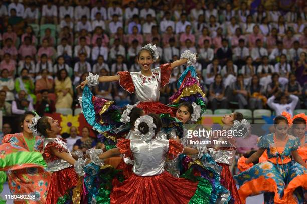 Students perform a cultural dance during the Excellence in Education Awards 2019, at Thyagaraj Sports Complex, on November 6, 2019 in New Delhi,...