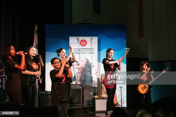 Students perform at Chicago Public School Announces Music Program Expansion With Little Kids Rock at Franklin Fine Arts Center Auditorium on February...