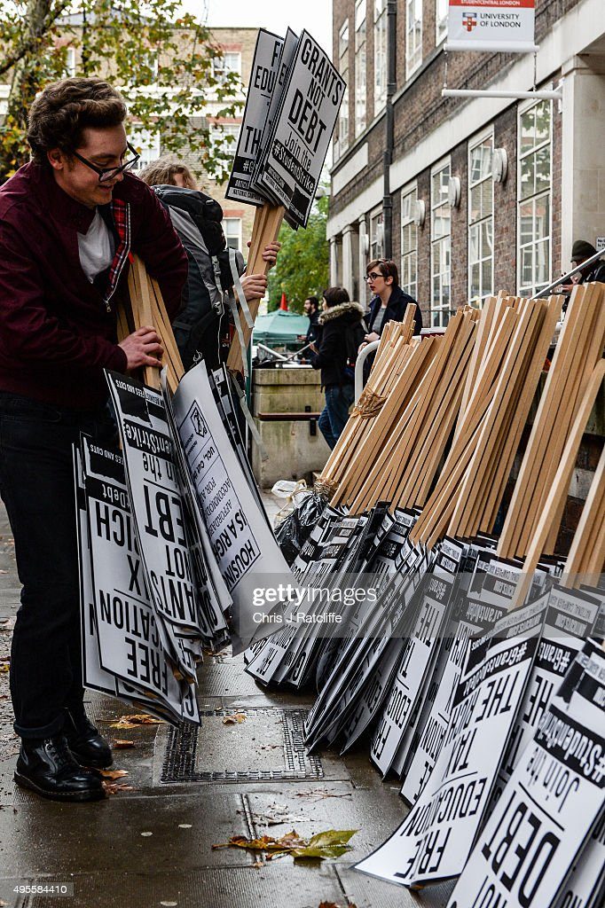 Students pick up placards and gather around the University of London on Malet Street to begin a demonstration against education cuts on November 4, 2015 in London, England. University students from across the country are marching on the streets of London to protest against cuts to free education. After a rally outside what was the University of London Union, the march will take in Parliament Square, Milibank - occupied by student protesters five years ago - and end in front of the Department for Business, Innovation and Skills (the department responsible for universities).