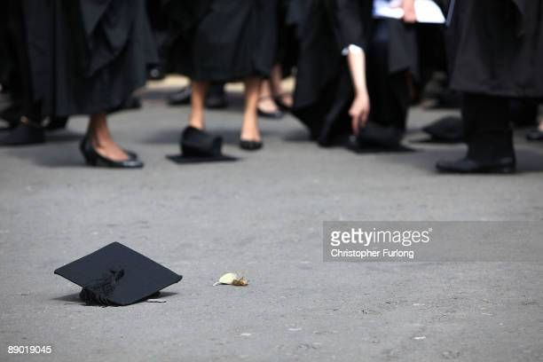 Students pick up their mortarboards after the offical hat throwing photograph at the University of Birmingham on July 14 2009 in Birmingham England...