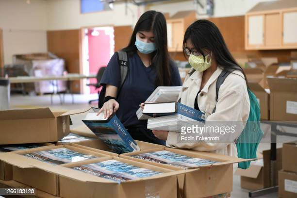 Students pick up their school books at Hollywood High School on August 13, 2020 in Hollywood, California. With over 734,000 enrolled students, the...