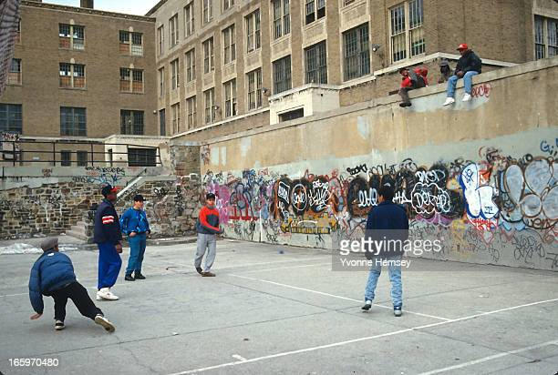 Students play handball in a public school defaced by graffiti January 21 1988 in New York City