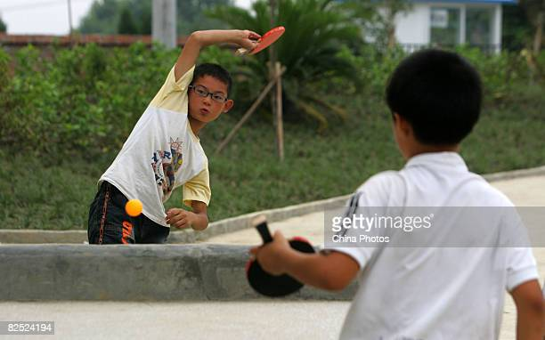 Students play table tennis as a rest during military training at the Liu Han Hope Primary School on August 23 2008 in Mianyang of Sichuan Province...