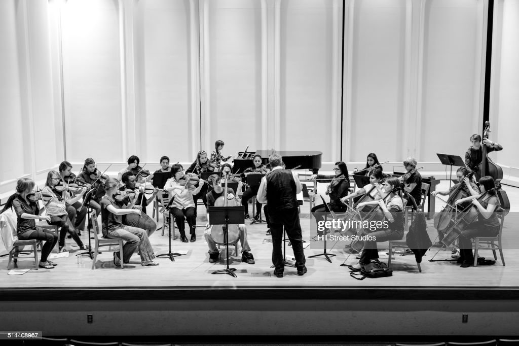 Students playing in college orchestra : Stock Photo