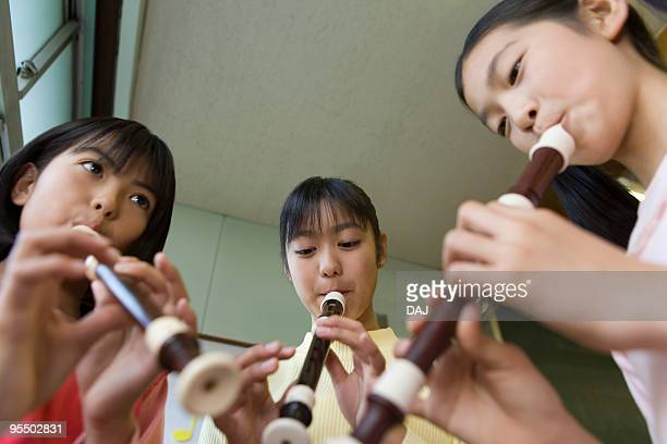 students playing instruments - recorder musical instrument stock photos and pictures