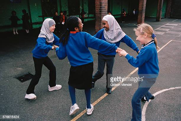 Students Playing Ring-Around-the-Rosy on School Playground