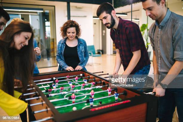 students playing table soccer - incentive stock pictures, royalty-free photos & images