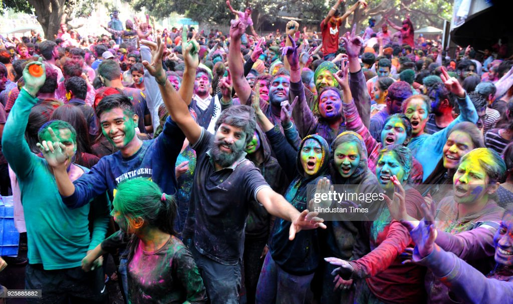 Students playing with colours ahead of Holi at Panjab University on March 1 2018 in Chandigarh India Holi is popular Hindu spring festival also known.