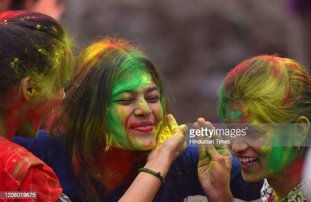 Students playing with gulal ahead of Holi festival outside Patna Women College at Bailey road on March 7 2020 in Patna India