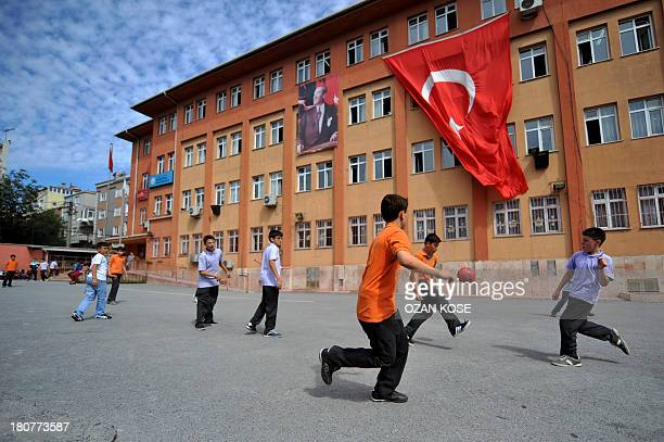 Students plays football at their school's playground during the first day of school on September 16 2013 at a primary school at Bayrampasa district...