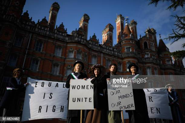 Students pose after recreating a suffragette protest march through the town centre at Royal Holloway University of London on February 6 2018 in Egham...