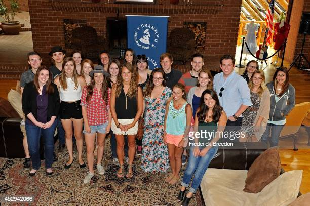 Students pose for a group photo with Sara Bareilles at the GRAMMY U SoundChecks With Sara Bareilles at The Woods Amphitheater at Fontanel on July 30...