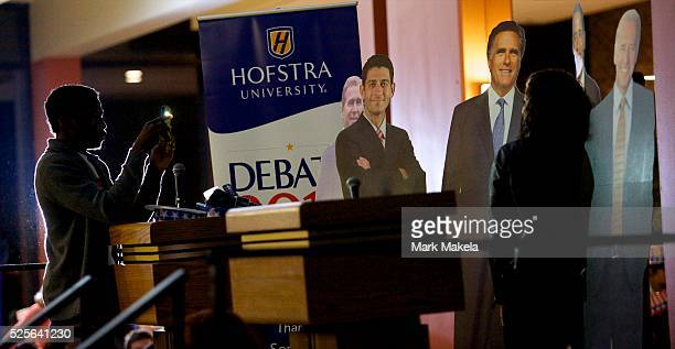 Students pose with cardboad cutout figures of Barack Obama Mitt Romney Paul Ryan Joe Biden and George W Bush during a debate watch party in the...