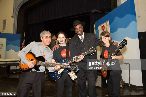 Students pose with Founder of Kids Rock David Wish and Nick Colionne at Chicago Public School Announces Music Program Expansion With Little Kids Rock...