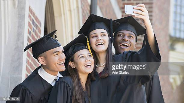 students posing for cell phone selfie at graduation - indian college girls stock photos and pictures