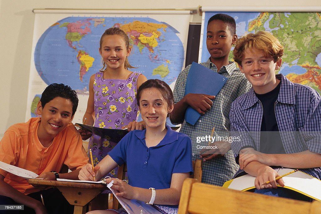 Students posing in the classroom : Stockfoto
