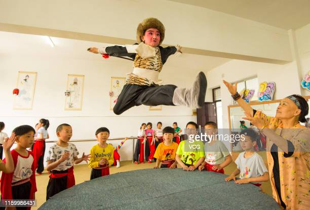 Students practice base skills during a Peking Opera class at Xichang primary school on May 25 2019 in Hai an Jiangsu Province of China There is a...