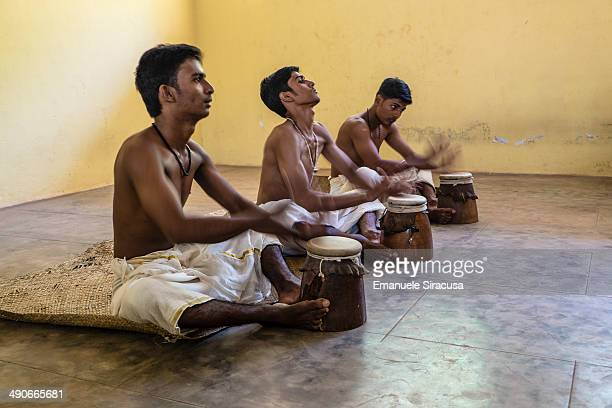 CONTENT] Students practice percussion at a classical indian music class at the Kerala Kalamandalam Art Academy in the Thrissur district in Kerala...