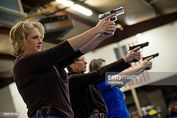 Students practice shooting an Airsoft guns during an all women class at the Oklahoma Personal Defense Academy in Shawnee Oklahoma US on Saturday Nov...