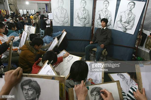 Students practice sketching during a lesson in a fine arts training school on March 9 2006 in Nanjing of Jiangsu Province China Fine art examinees...