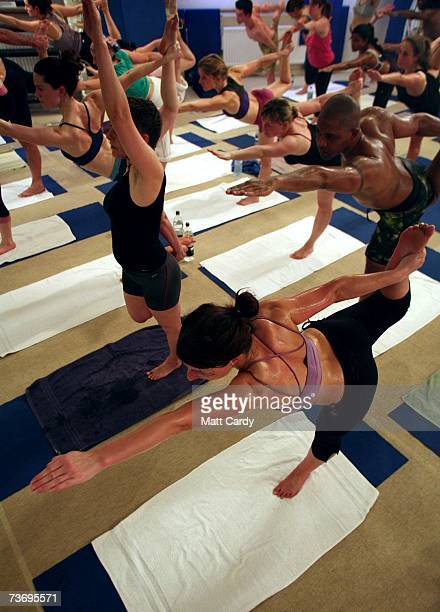 Students practice the unique Bikram Yoga at the City Studio on March 13 2007 in London England The Bikram Yoga also known as Hot Yoga is a style of...
